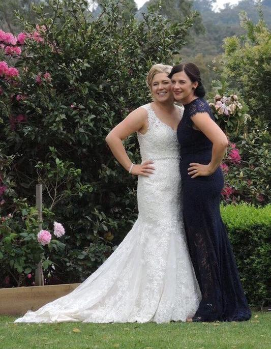 Mother of the Bride Customer wearing navy gown by Elle Zeitoune