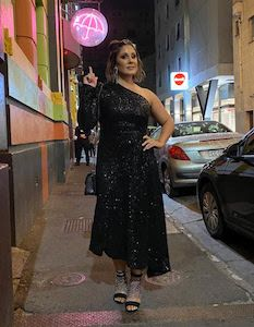 Adelaide customer wearing a formal black sequin Rebecca Vallance dress