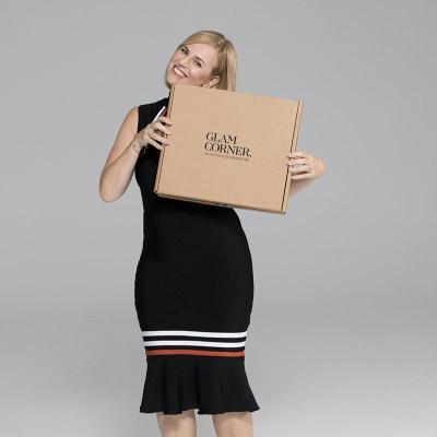 Customer wearing a black midi dress by Elliatt