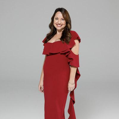 Customer wearing a ruby midi dress by Pasduchas