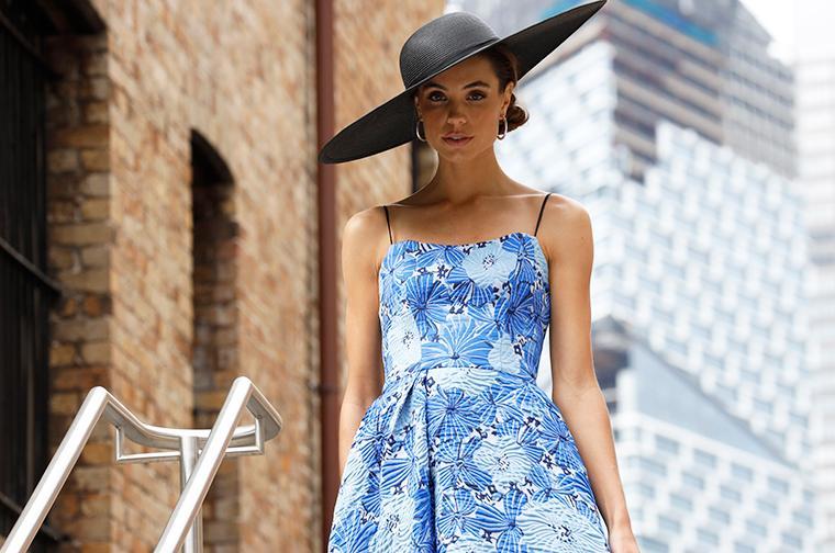 Model wearing blue love honor dress.