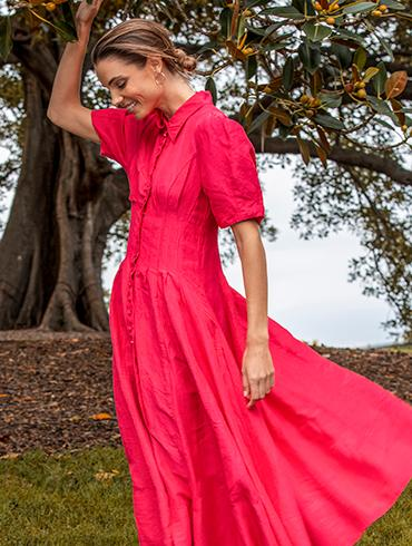 Model wearing pink country road dress.