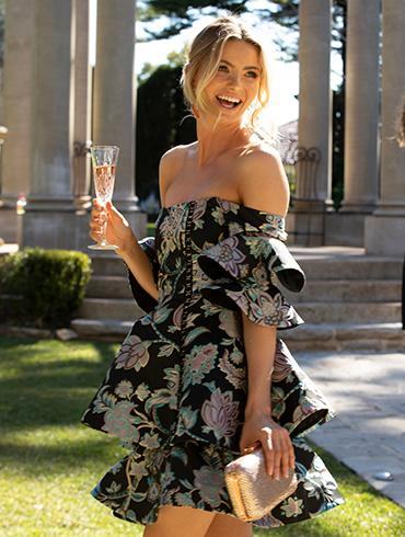 Model wearing off shoulder Thurley mini dress.