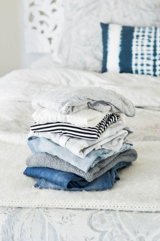 clothing piles - cleaning out your closet