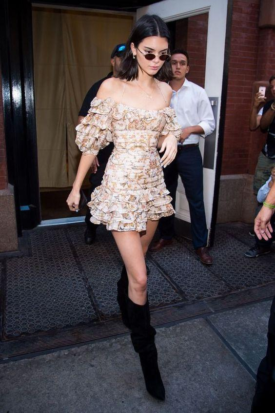 Kendall Jenner looking super girly in a mini dress and knee high boots.
