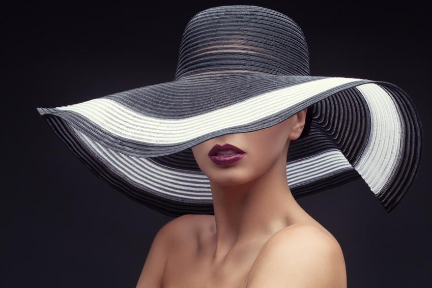 Woman in big summer hat